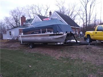 20 ft. Fishing/pontoon boat excellent condition.